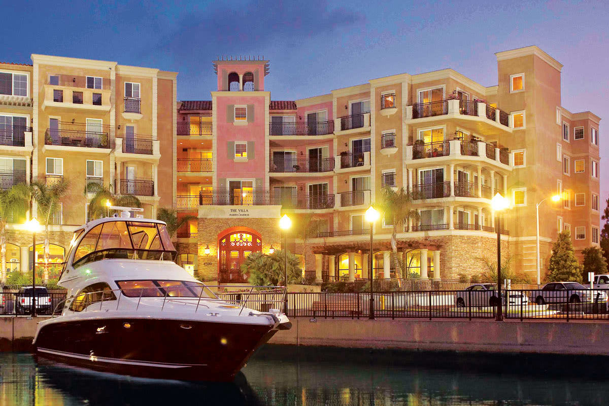 Boat at the dock in front of The Villa at Marina Harbor in Marina del Rey, California