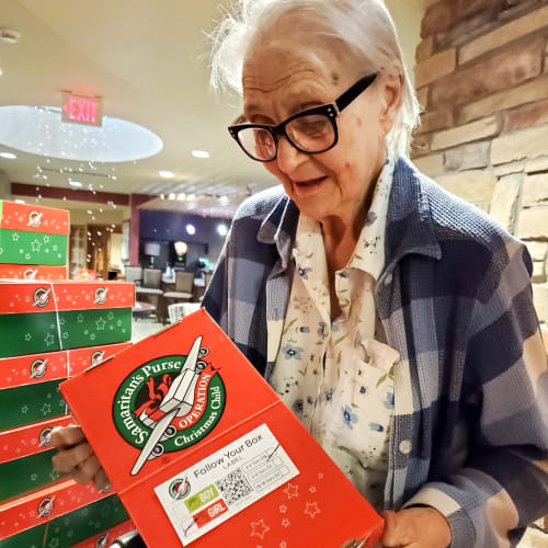 Resident holding a gift box at The Oxford Grand Assisted Living & Memory Care in Wichita, Kansas