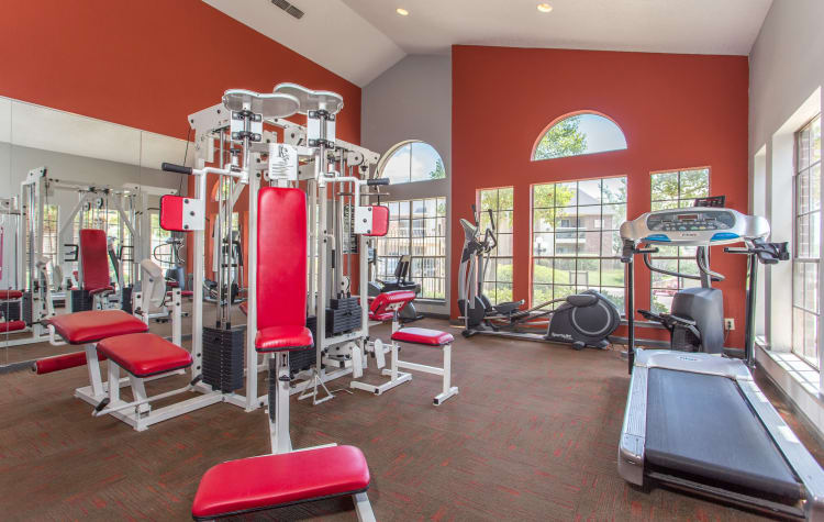Fitness center for residents with individual workout stations at Laurel Heights at Cityview in Fort Worth, Texas