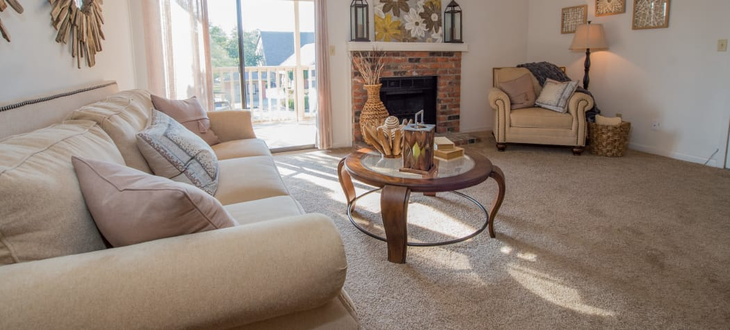 Spacious living room with a fireplace at The Mark Apartments in Ridgeland, Mississippi