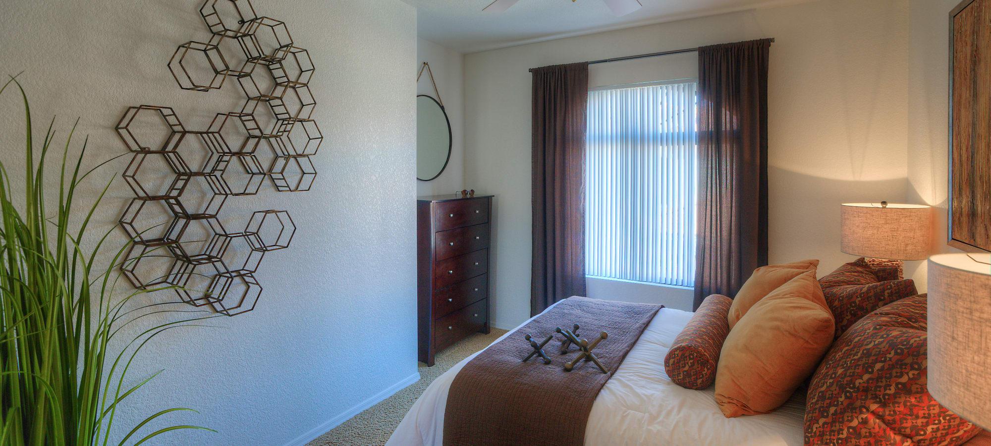 Model bedroom with unique decor at San Prado in Glendale, Arizona