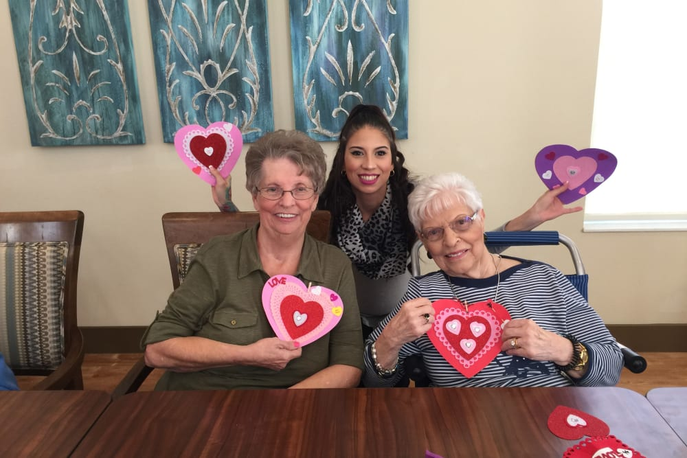 Making Valentine's Day Crafts at Merrill Gardens at Solivita Marketplace in Kissimmee, Florida.