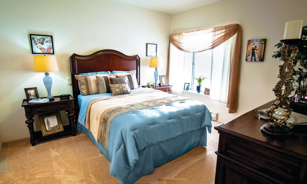 Well-decorated resident bedroom at Camden Springs Gracious Retirement Living in Elk Grove, California