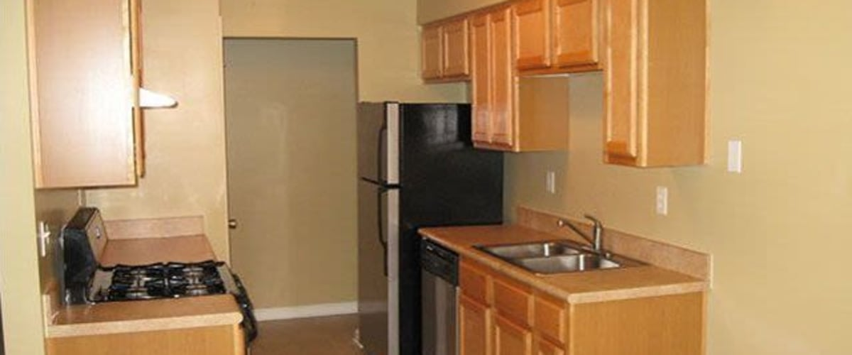 A kitchen with appliances at Meadow Wood Apartments in Smyrna, Tennessee