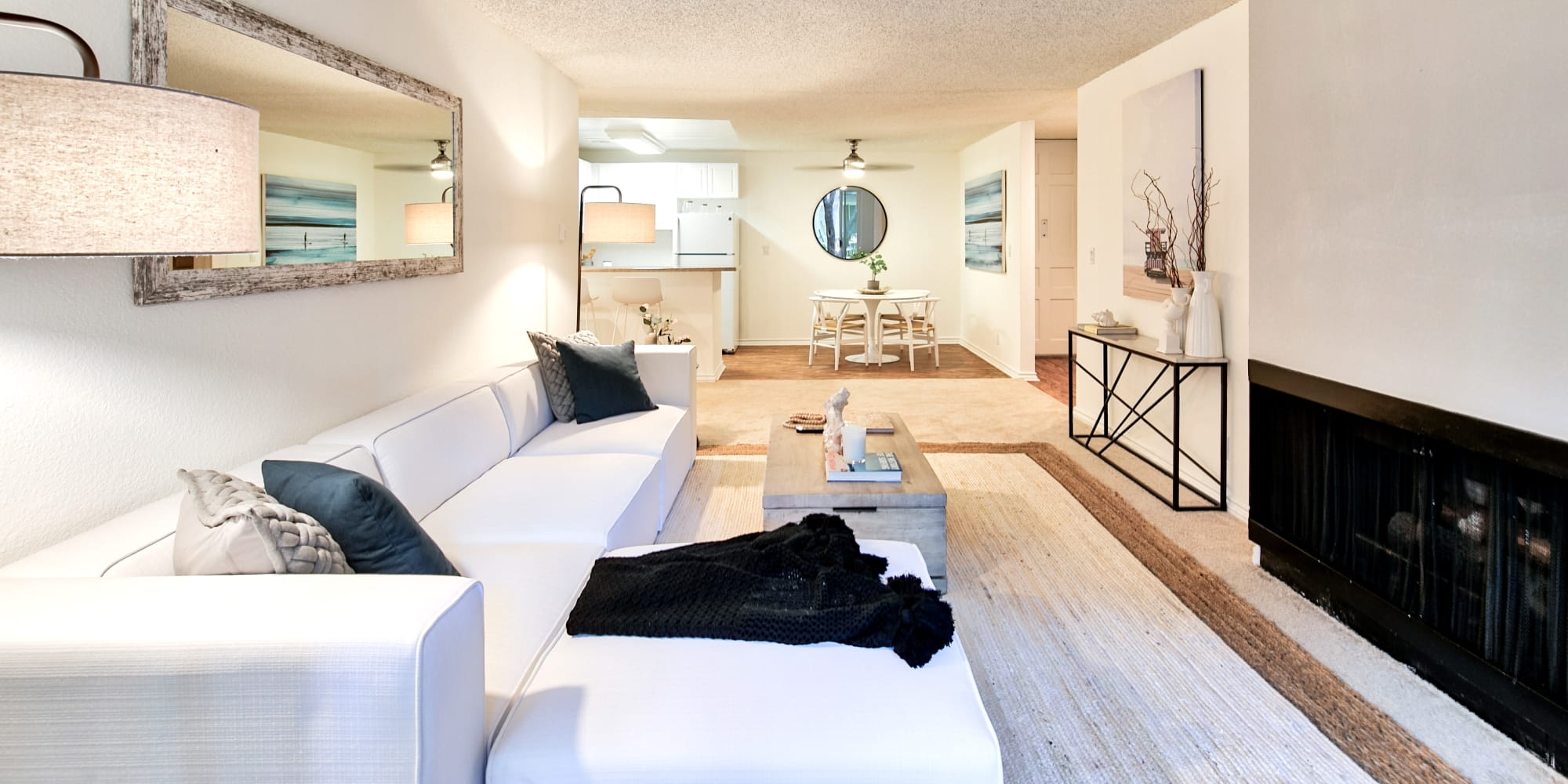 Well-furnished model home's living area at The Meadows in Culver City, California