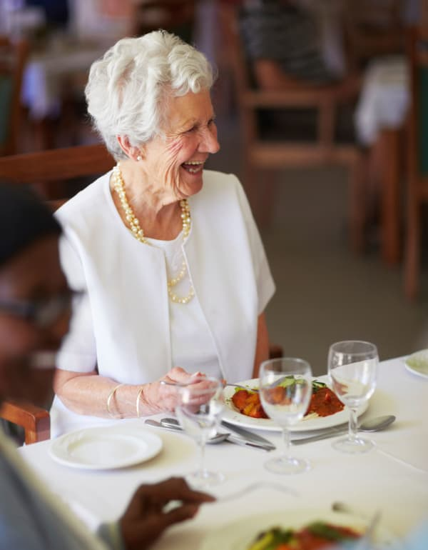 Resident enjoying dinner at The Retreat at Fisherville in Stuarts Draft, Virginia