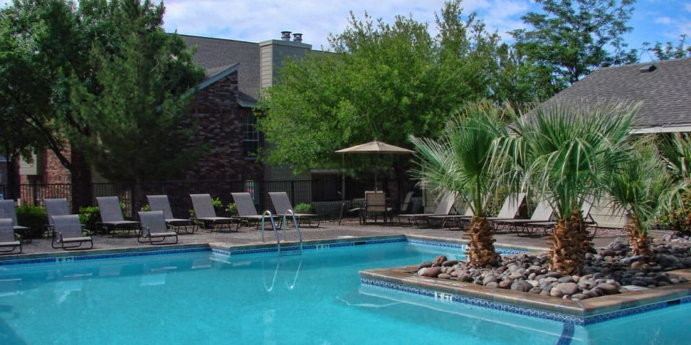 A community pool at The Chimneys Apartments's business center in El Paso, Texas