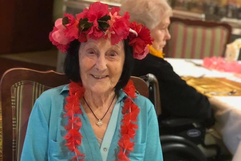 A resident dressed for a tropical themed day at Cypress Pointe Health Campus in Englewood, Ohio