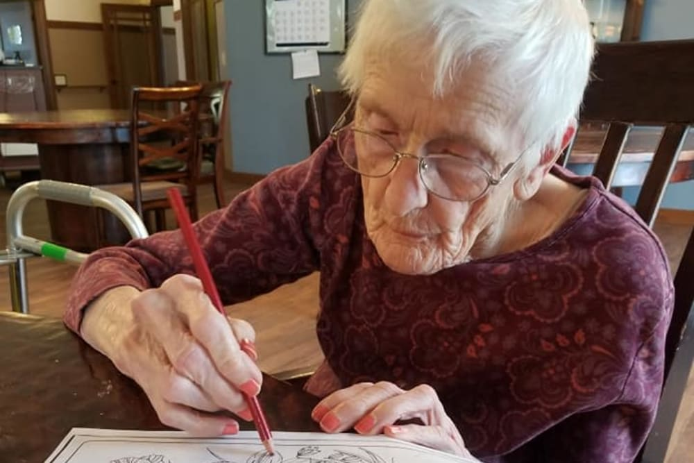 A resident working on a drawing at The Landings of Kaukauna in Kaukauna, Wisconsin