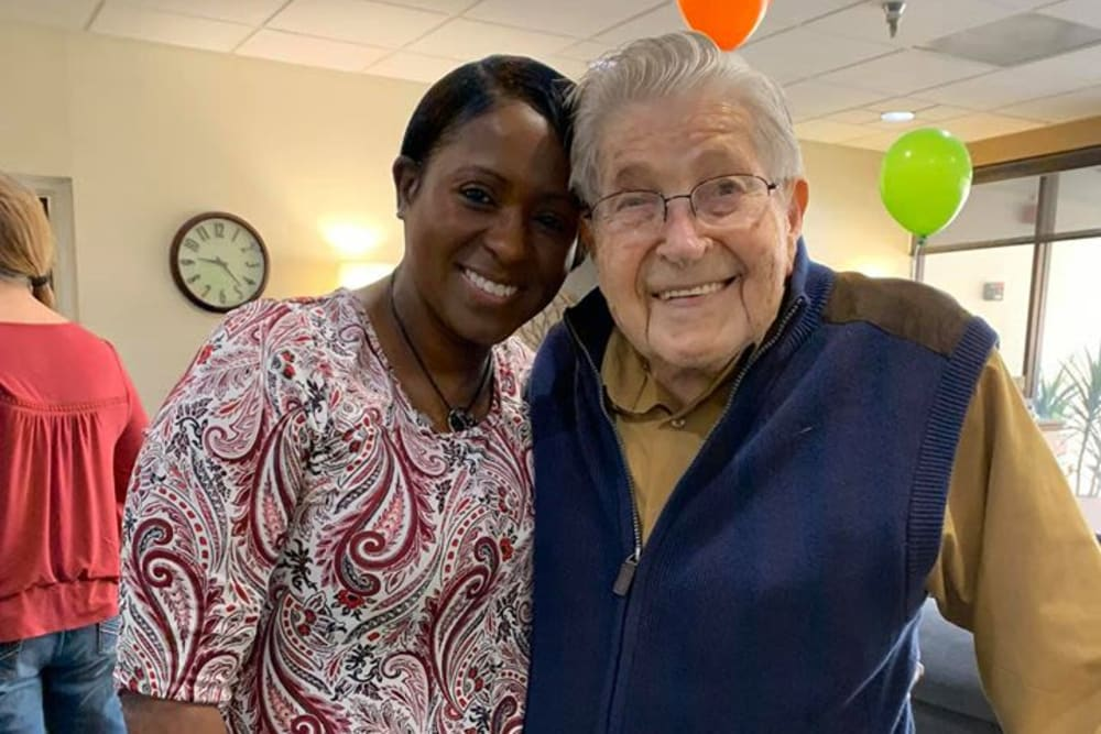 A happy resident with a staff member at Lake Morton Plaza in Lakeland, Florida