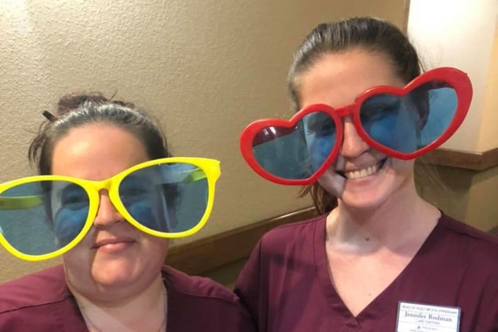 Caregivers with funny over sized sunglasses on at Villas of Holly Brook Effingham in Effingham, Illinois
