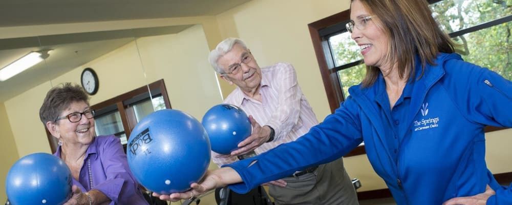 Residents working with fitness instructor at The Springs at Carman Oaks in Lake Oswego, Oregon