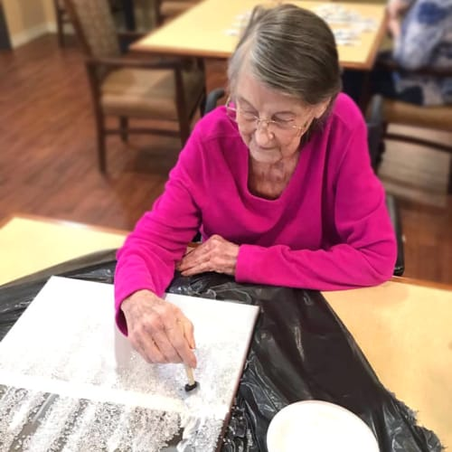 Resident painting at Oxford Glen Memory Care at Grand Prairie in Grand Prairie, Texas