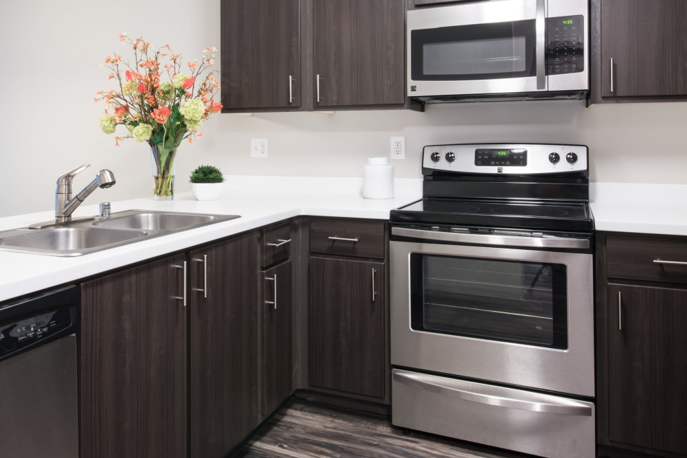 A kitchen with plenty of cabinet space at Brookside Village in Auburn, Washington