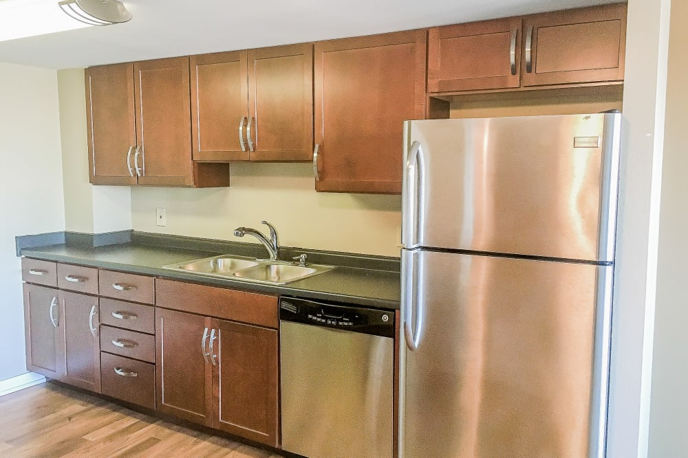 Kitchen with stainless steel appliances at The Parker @ Seventh in Des Moines, Iowa