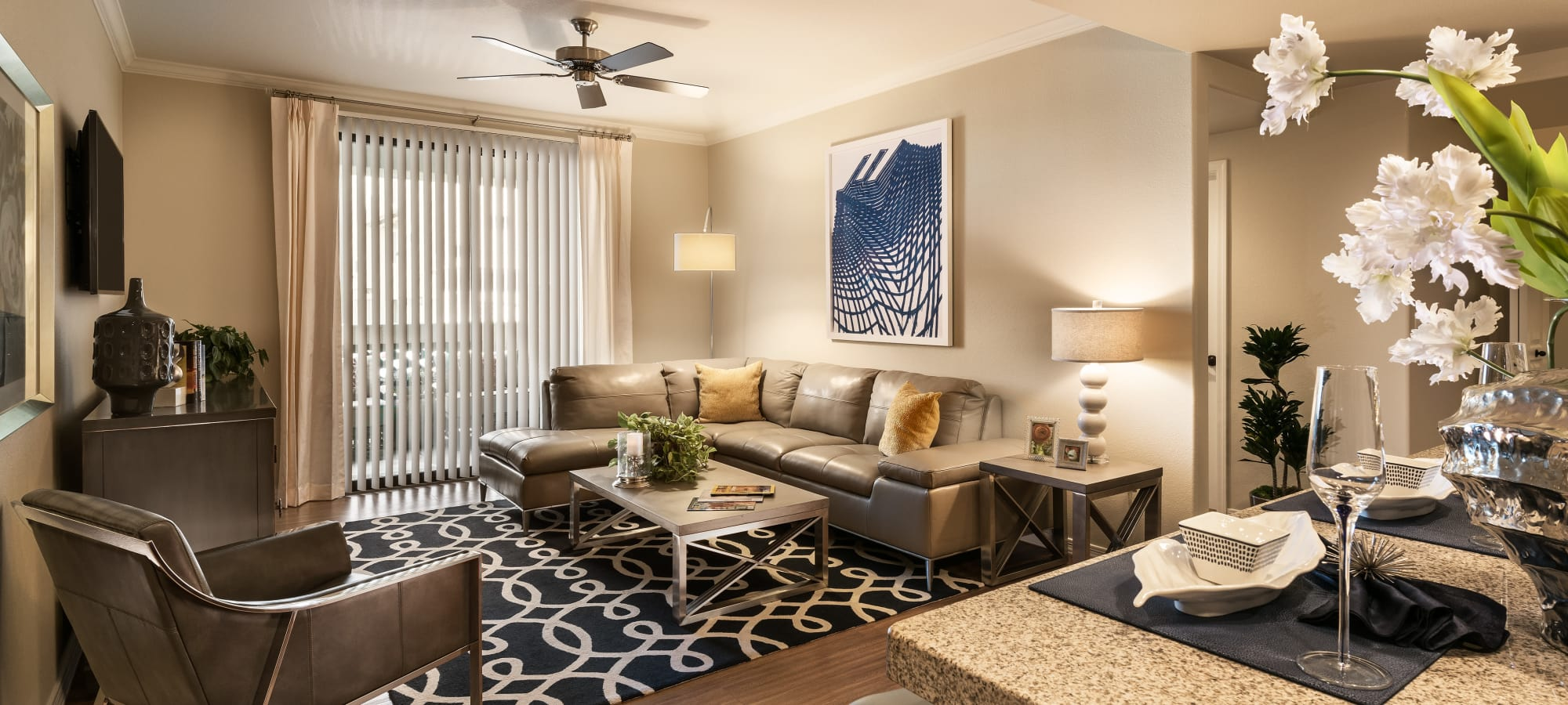 Model living room with ceiling fan at San Sonoma in Tempe, Arizona