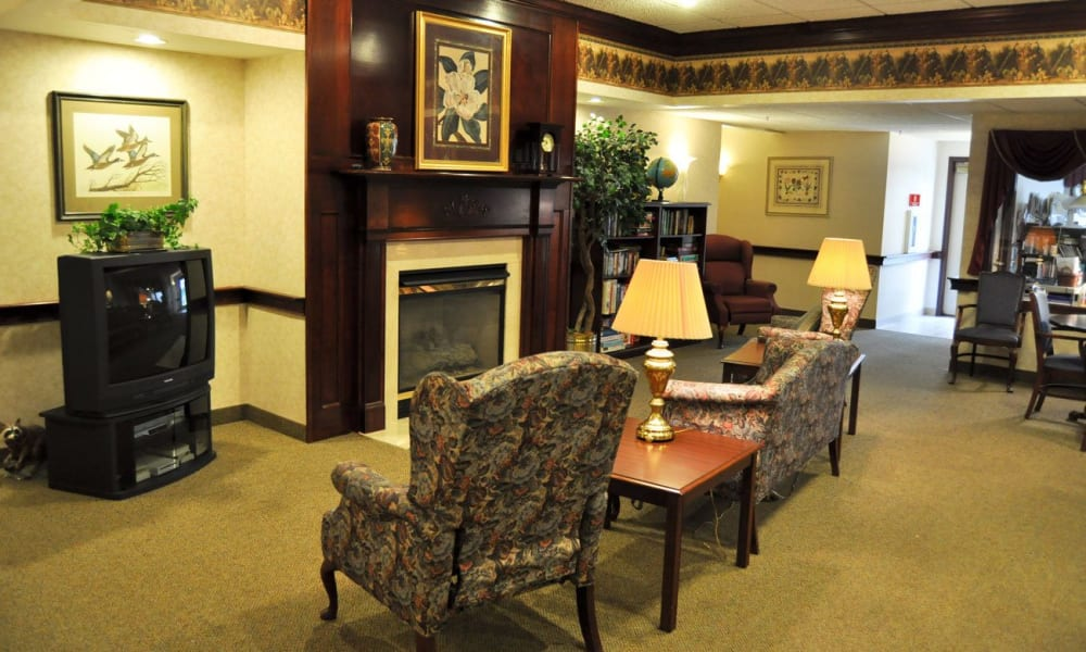 tv room with a fireplace at Governor's Pointe in Mentor, Ohio