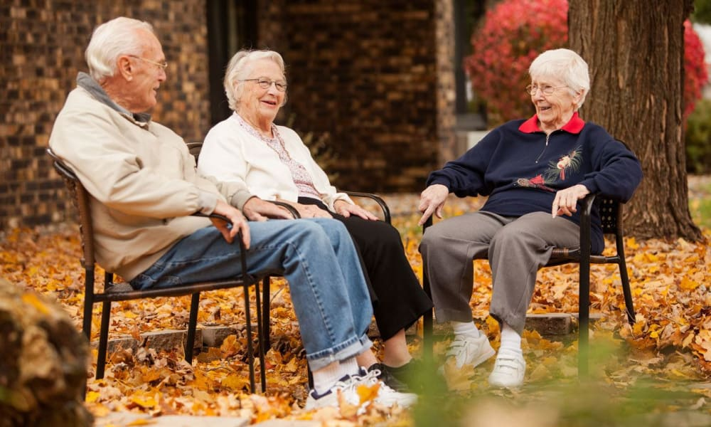 Residents sitting outside at White Oaks in Lawton, Michigan