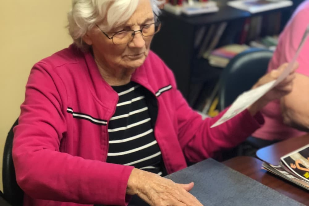 Female resident enjoying arts and crafts time at  Scenic Hills Care Center in Ferdinand, Indiana