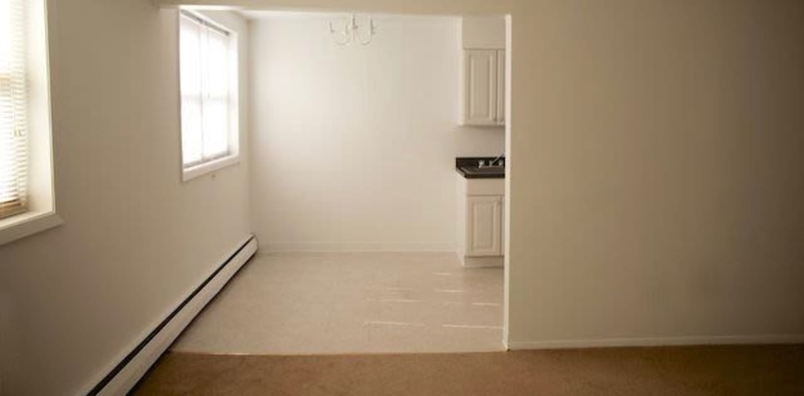 Open living room and kitchen with space  for a kitchen table in Collingswood, New Jersey at Marina Park Apartments
