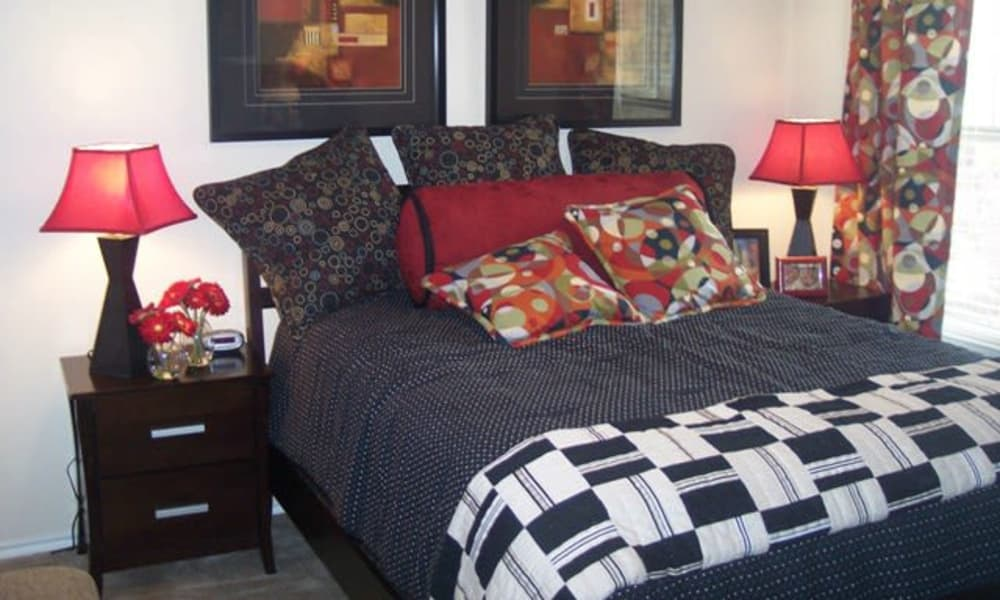 Naturally well-lit bedroom at Stone Lake Apartments in Grand Prairie, Texas