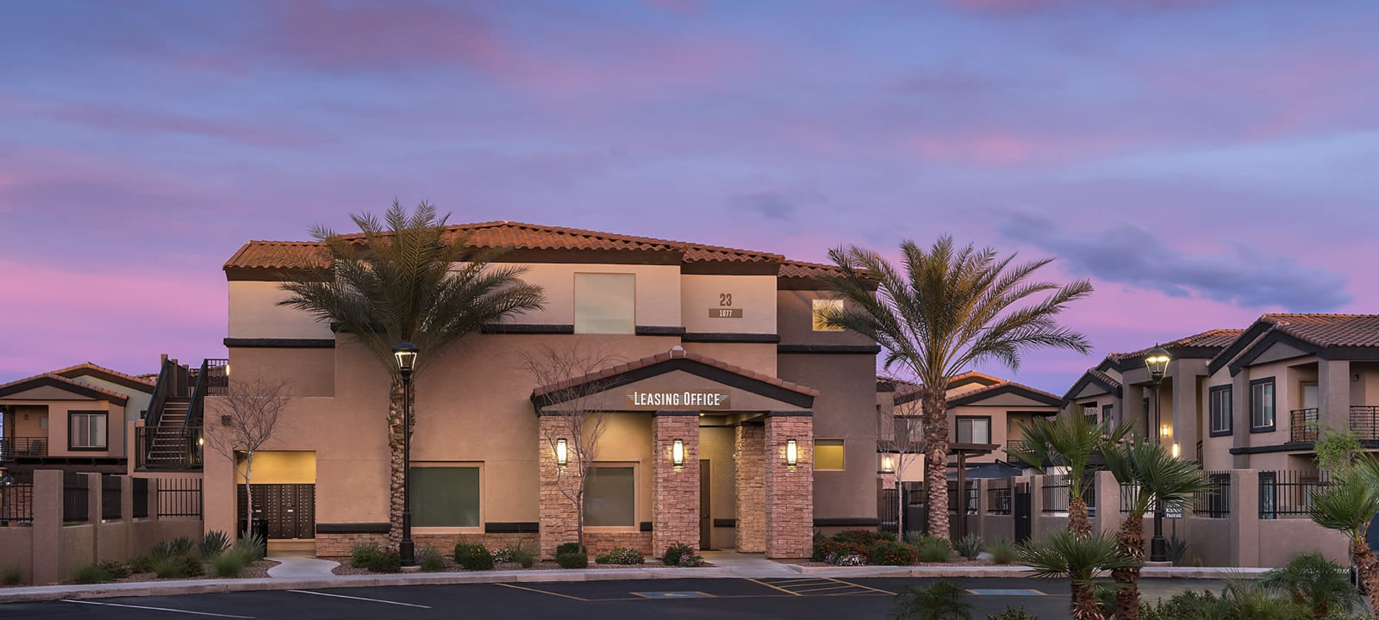 Beautifully landscaped front entrance at The Maxx 159 in Goodyear, Arizona
