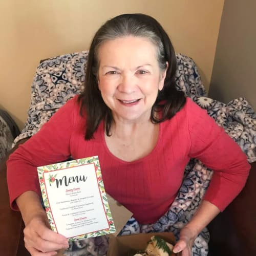 Resident holding a menu at The Oxford Grand Assisted Living & Memory Care in McKinney, Texas