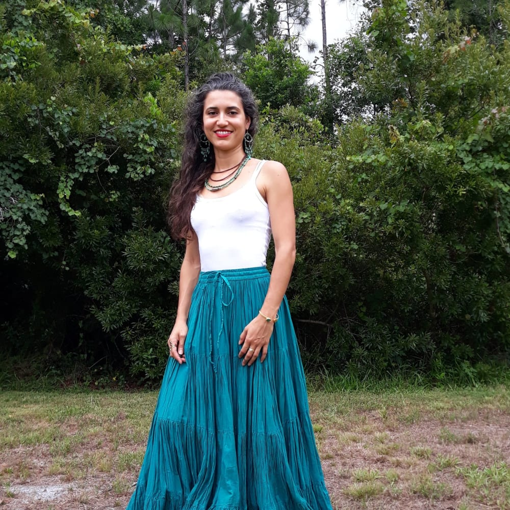 Yoga Instructor wearing traditional dress in open field