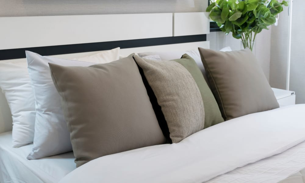 Bed with pillows at The Venue in Rochester, New York