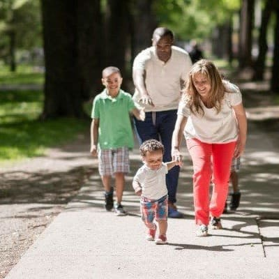 Family walking at Maplewood Estates Apartments in Hamburg, New York.