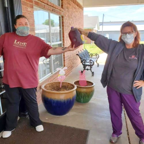 Masked caretakers socially distanced at Canoe Brook Assisted Living in Ardmore, Oklahoma