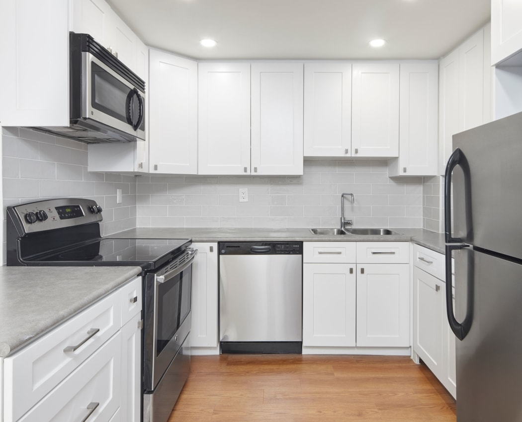 Lovely kitchen with stainless-steel appliances at Bristol Court in Mississauga, Ontario