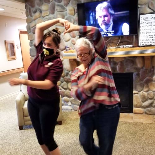 Resident dancing with a caretaker at The Oxford Grand Assisted Living & Memory Care in Wichita, Kansas