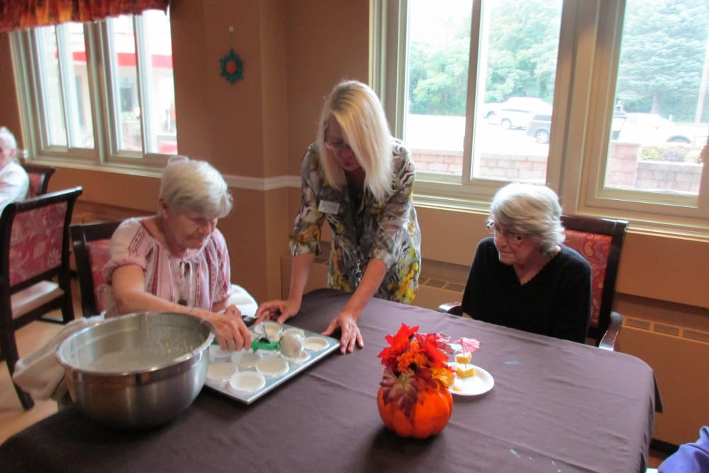 Residents making cupcakes at The Woods of Caledonia in Racine, Wisconsin