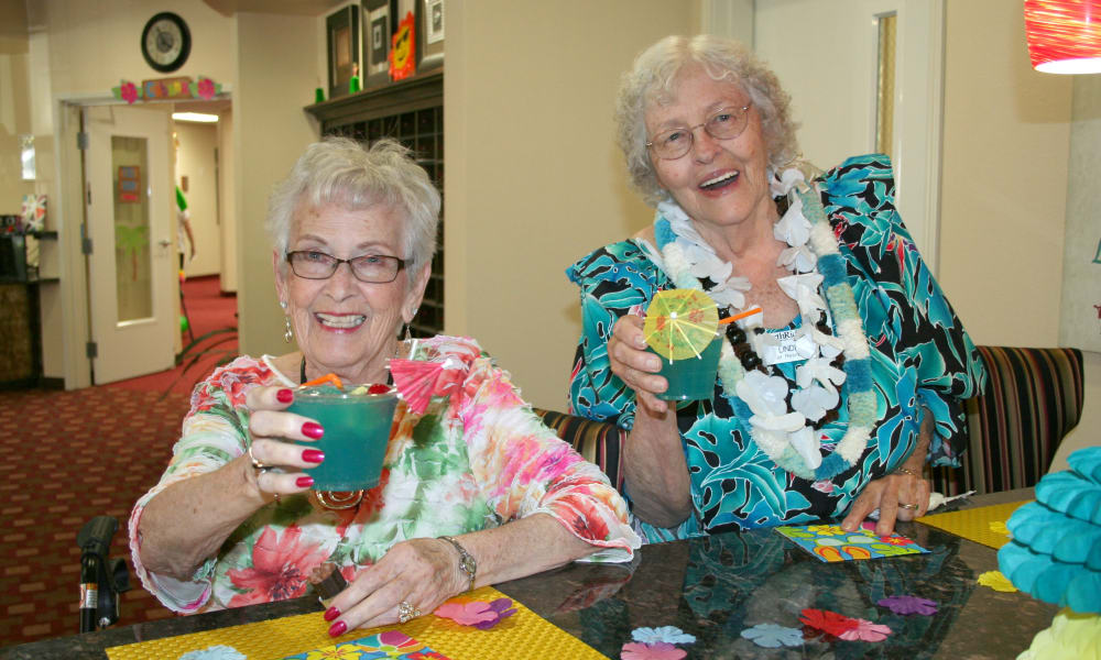 Residents raising their glasses in a toast at Alexis Estates Gracious Retirement Living in Allen, Texas