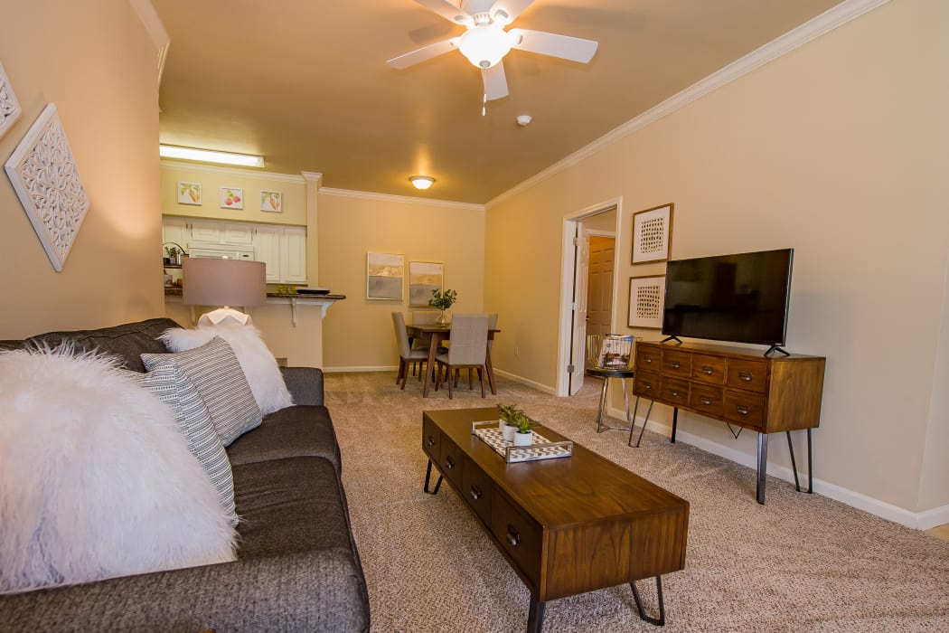 Wonderful living room with ceiling fan at Lexington Park Apartment Homes in North Little Rock, Arkansas