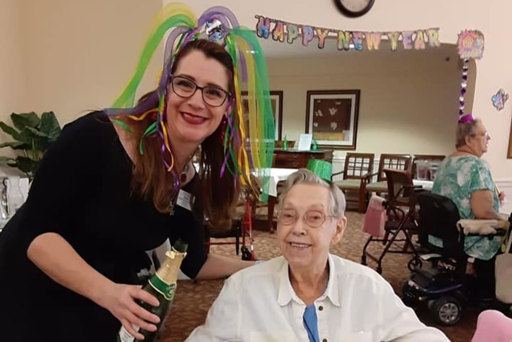 A resident and a caregiver celebrating New Year's day at Eastlake Terrace in Elkhart, Indiana