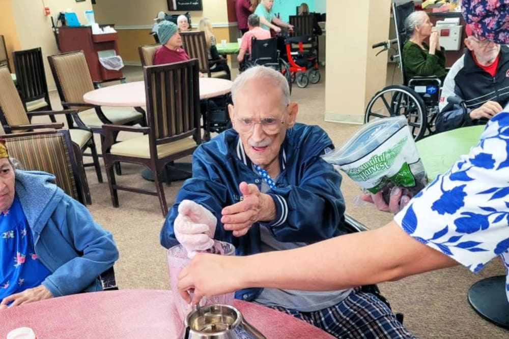 Planting herbs with residents at Woodland Palms Memory Care in Tucson, AZ