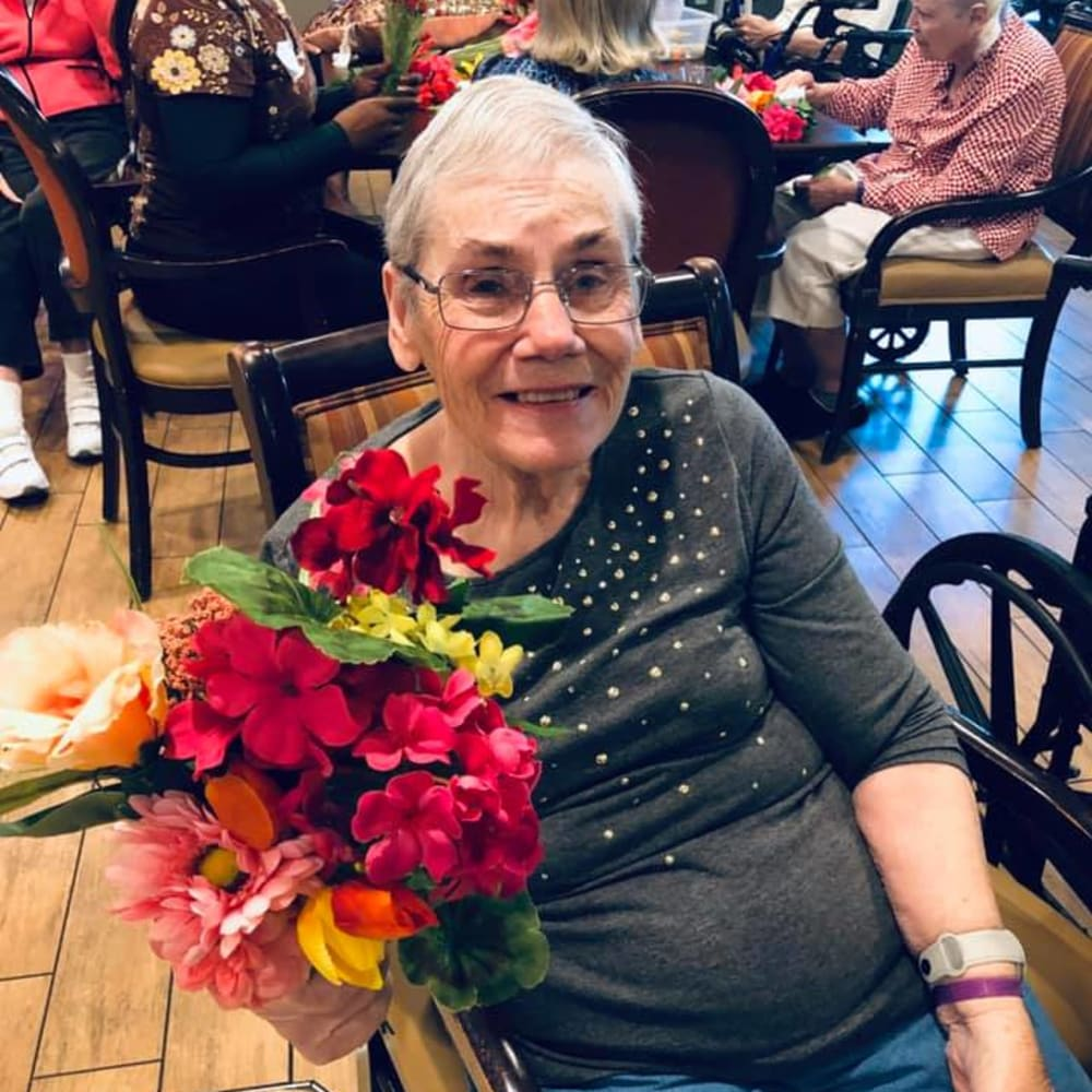 A resident received flowers at Inspired Living Tampa in Tampa, Florida