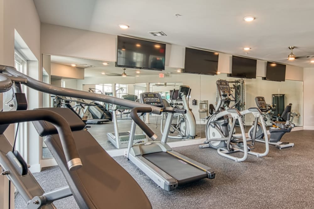 A fitness center with lots of flat-screen TVs at Marina Villa in Norfolk, Virginia
