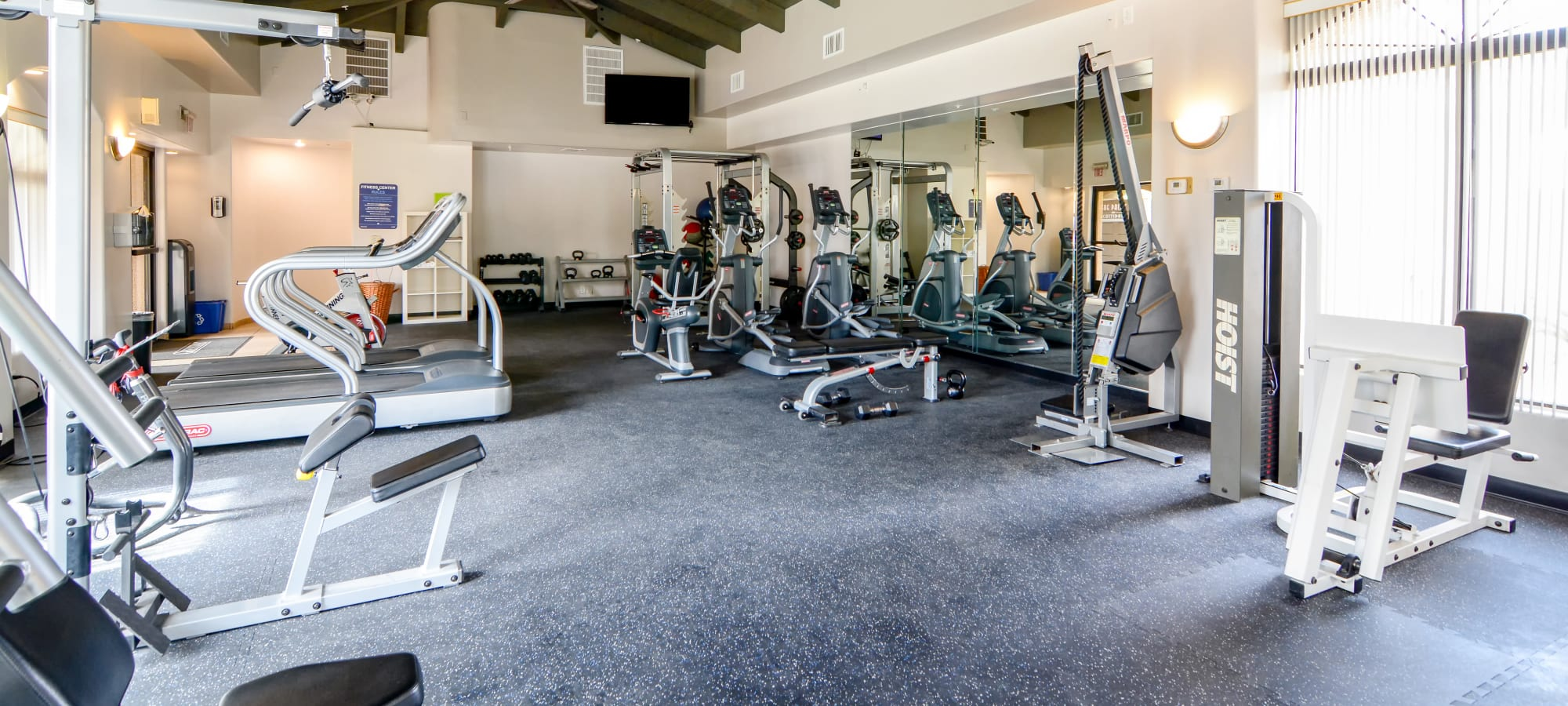 Fitness center with TV at The Palms on Scottsdale in Tempe, Arizona