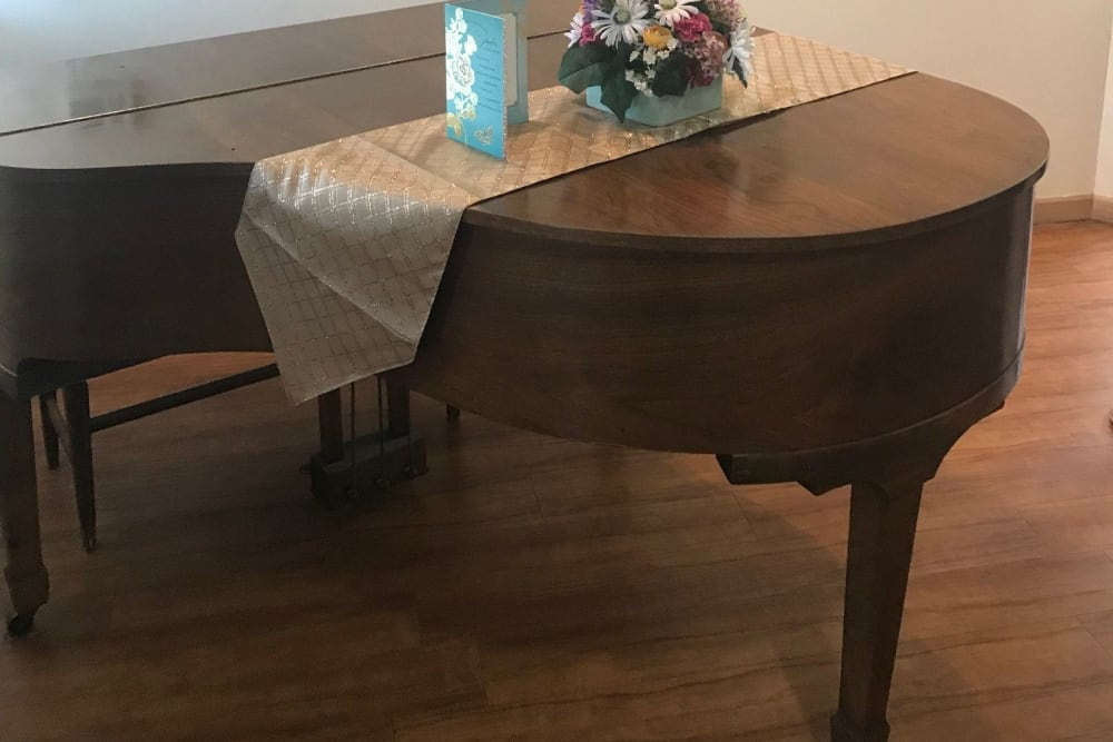 Baby grand piano in community music room at Ramsey Woods in Cudahy, Wisconsin.