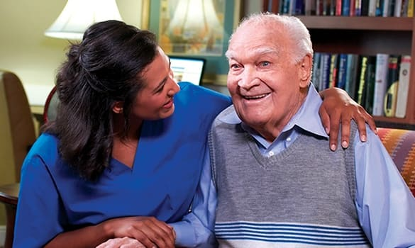 Caregiver and resident at Burr Ridge Senior Living in Burr Ridge, IL