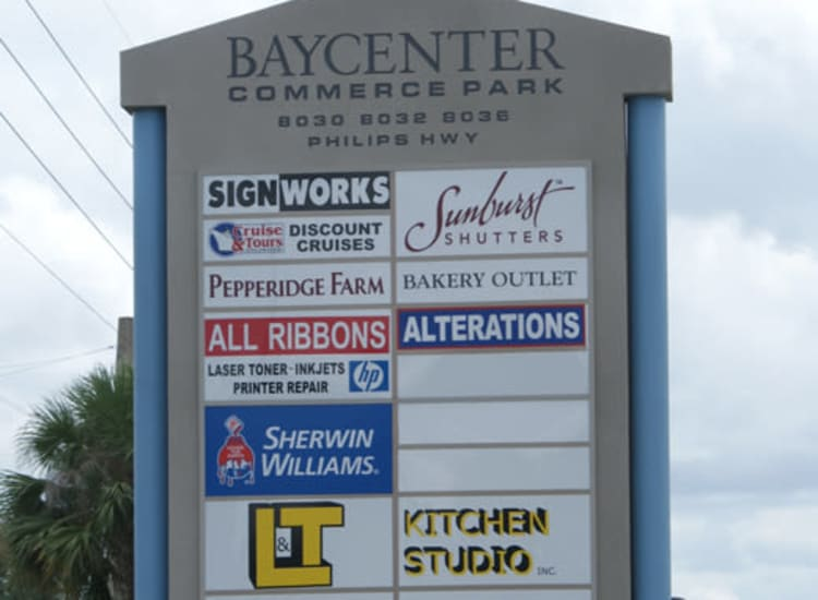 Sign displaying all the tenants at Fort Family Investments's commercial property, Baycenter Commerce Park, in Jacksonville, Florida