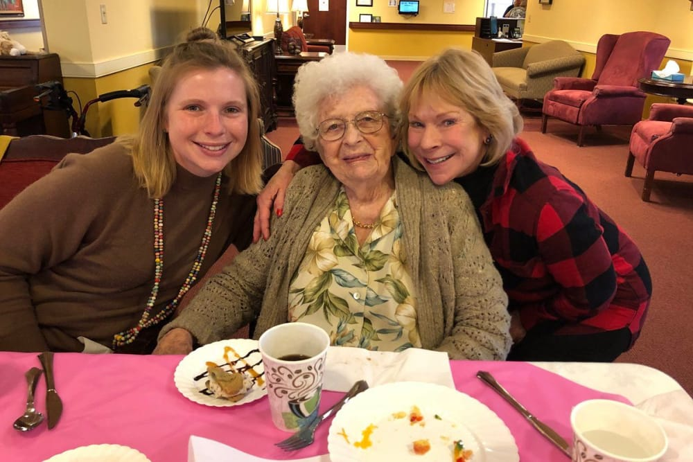 Female resident and staff members enjoy delicious desserts and coffee at The Willows at East Lansing in East Lansing, Michigan