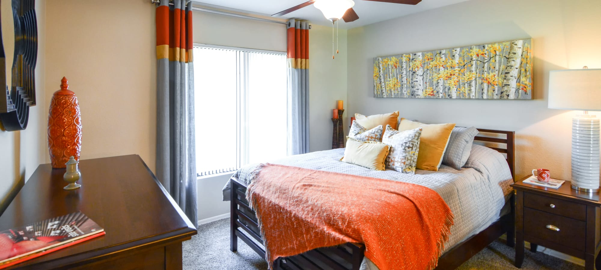 Orange and grey bedroom at The Palms on Scottsdale in Tempe, Arizona