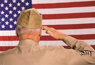 Veteran salutes flag proudly at Discovery Commons At Bradenton in Bradenton, Florida