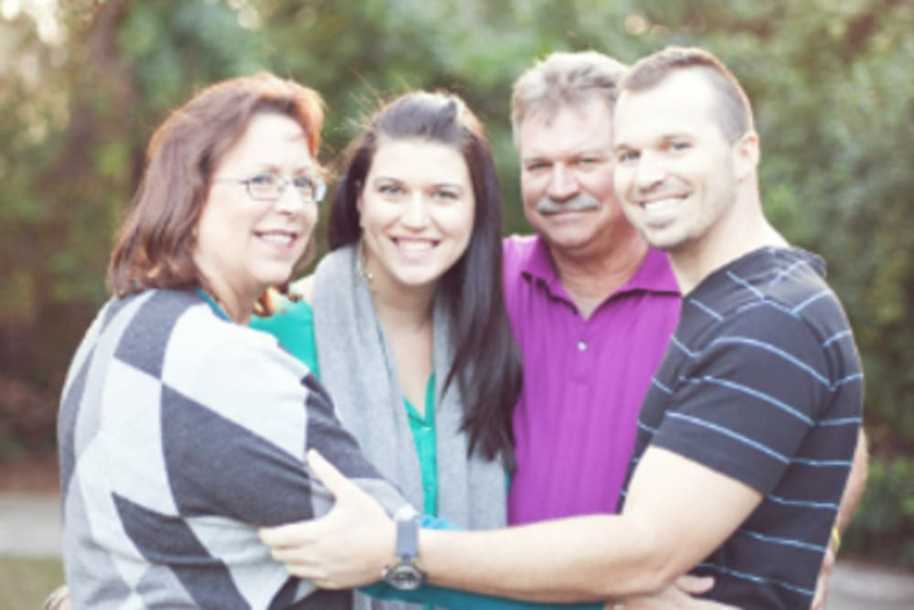 Courtney with her family near Inspired Living.