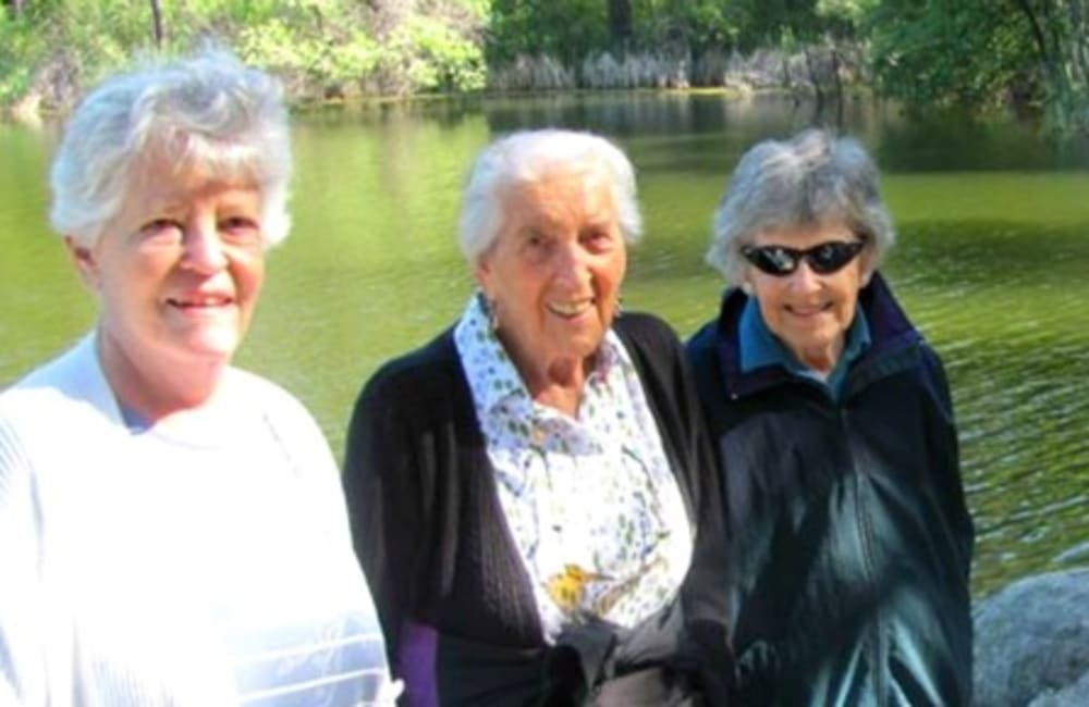 Residents enjoying an day out by a nice pond near Hilltop Commons Senior Living in Grass Valley, California
