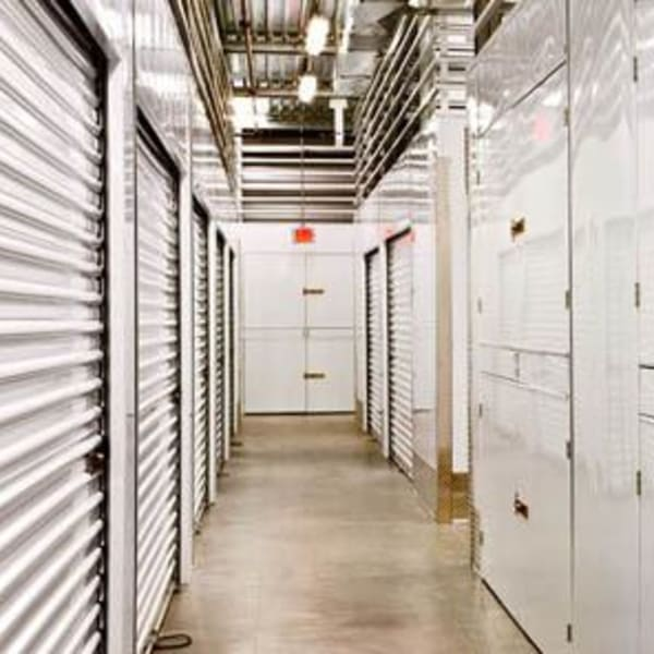 Indoor storage units with white doors at StorQuest Self Storage in Thousand Oaks, California